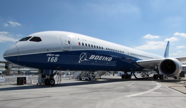 Boeing wins first-half orders battle, but deliveries slump